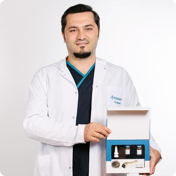 Dr. Balwi hält ein NEO FUE Kit von Elithair